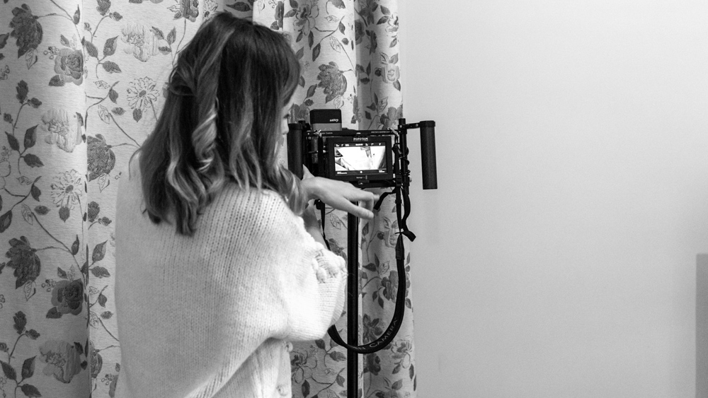 maria nistor with wooden camera director's monitor cage and vaxis wireless by popotam productions video agency timisoara