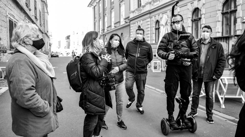 maria nistor and costin marian filming with blackmagic ursa mini pro on a segway ninebot s in timisoara by popotam productions video agency